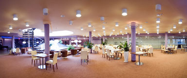Hotel dining room panorama. The interior of a hotel ballroom (restaurant and dining room), deserted. 180 degrees panorama royalty free stock photo