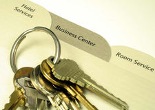 Hotel Directory and Keys. This is a close up image of three tabs from a hotel room directory and a ring of keys royalty free stock photo