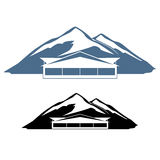 Hotel do logotipo nas montanhas Fotografia de Stock