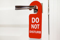 Hotel do not disturb busy. Hotel do not disturb red sign on white door Royalty Free Stock Photos