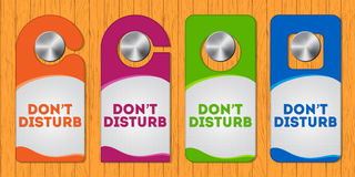 Hotel do not disturb door hanger with special desi Stock Photos