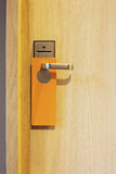 Hotel door. With orange card to avoid disturbing Stock Images