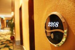 Hotel door. Hotel corridor in China. Focus on room sign Stock Images