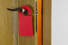 Red Door Hanger. Hotel door handle with blank paper hanger Stock Images