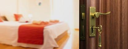 Hotel doorway with open door, blur bedroom background. 3d illustration Stock Photography