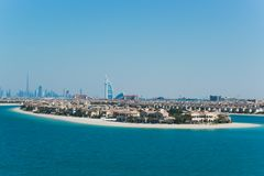 Hotel in Dubai and blue sea. Beautiful view of the hotel in Dubai, United Arab Emirates, surrounded by sea and light blue sky Stock Photos