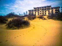Hotel on dune royalty free stock photos