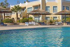 Hotel in Egypt with a swimming pool with sun loungers Royalty Free Stock Photography