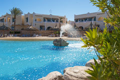 Hotel in Egypt with a swimming pool with sun loungers Stock Image