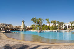 Hotel in Egypt with a swimming pool with sun loungers Stock Photos