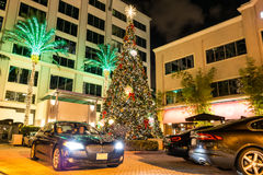 Hotel entrance on Las Olas Boulevard in Ft Lauderdale, Florida. Night view of hotel entrance, christmas tree and cars on Las Olas Boulevard in Fort Lauderdale Stock Photo