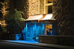 Hotel Entrance at Night. Entrance to an upscale hotel and lodge at night with blue atmosphere lighting at doorway royalty free stock images
