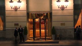 Hotel entrance night time lapse, visitors guests come in out. Stock footage stock video footage