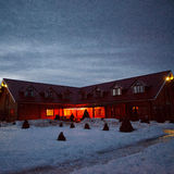 Hotel in the evening in the winter Stock Image