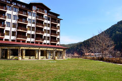 Hotel exterior.Mountain hotel with wooden balconies Royalty Free Stock Photo