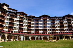 Hotel exterior.Mountain hotel with wooden balconies Royalty Free Stock Photography