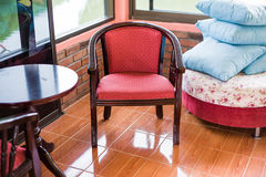 Hotel exterior with table, red chairs Stock Photo