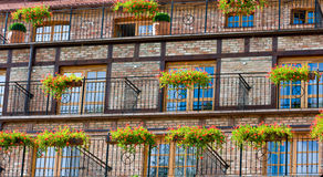 Hotel facade. Abstract image of a new hotel, red brick facade with timber beams Royalty Free Stock Images