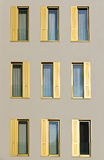 Hotel facade with golden shutters Stock Images