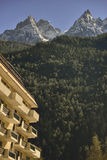 Hotel facade and Red peaks from Aiguilles mountains Stock Photo
