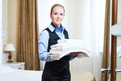 Hotel female housekeeping worker with linen Stock Photo