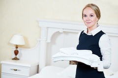 Hotel female housekeeping worker with linen Royalty Free Stock Images