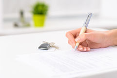Hotel form and room keys resting on the counter Royalty Free Stock Photos