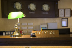 Hotel front desk 3. Hotel front desk with focus on reception sign. Made with shallow depth of field Stock Photos