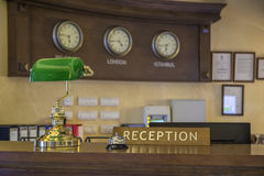 Hotel front desk. With focus on reception sign. Made with shallow depth of field Stock Image