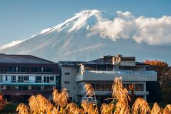 A hotel in Fujikawaguchiko with Mount Fuji with the legendary sn. Fujikawaguchiko, Japan -November 10, 2018: A hotel in Fujikawaguchiko, a Japanese resort town royalty free stock photography