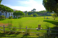The hotel and golf course on a sunny day Royalty Free Stock Photos
