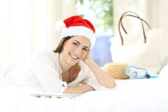Hotel guest looking at you on christmas holidays. Lying on a bed in an hotel room royalty free stock image