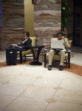 Hotel guests. Waiting in an upscale hotel lobby Royalty Free Stock Image