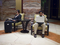 Hotel guests. Waiting in an upscale hotel lobby Royalty Free Stock Photos