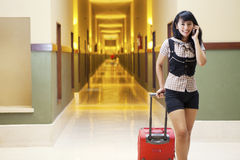 Hotel guests at aisle. Asian woman chatting on the phone shot in a 5 stars hotel aisle stock photos