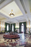 Hotel hall. Ornate hotel hall with a chandelier and fountain Stock Photo
