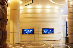 Hotel hall corridor. Hotel corridor with  tv set screen, illuminated by led  light Stock Photo