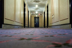 Hotel Hallway. Interior of a hotel hallway with doors on the sides and at the end Royalty Free Stock Photography