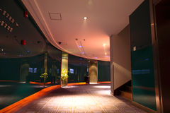 Hotel hallway. A curve hallway with carpet in the modern hotel Stock Images