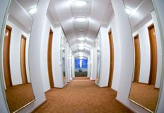 Hotel hallway. Fish-eye view of a hotel hallway, two large mirrors on the walls Royalty Free Stock Photography