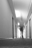 Hotel hallway. Person walking in a hotel hallway, motion blur Royalty Free Stock Photo