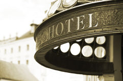 Hotel header. Close up of hotel header inscription. Sepia tone. Shallow DOF Royalty Free Stock Photos