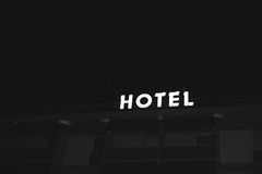 Hotel illuminated neon sign Stock Photos