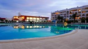 Hotel with illuminated swimming pool Stock Image