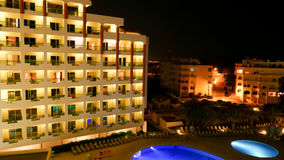 Hotel with illuminated swimming pool at night Royalty Free Stock Photo