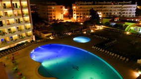 Hotel with illuminated swimming pool at night Royalty Free Stock Photography
