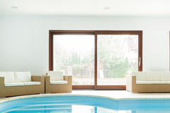 Hotel with indoor swimming pool Stock Photography