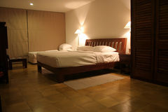 Hotel interior. Interior of a 5 star hotel bed room in a Tropical Country Stock Photography