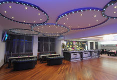 Hotel Interiors. Beautifully designed interiors of a modern hotel with circular lighting on the ceiling Stock Photos