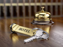 Hotel key and reception bell Royalty Free Stock Images